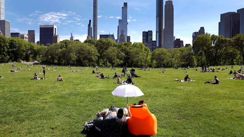 Mandatory Credit: Photo by Peter Foley/EPA-EFE/Shutterstock (10649806g)People adhere to social distancing guidelines in Central Park in New York, New York, USA, 17 May 2020.