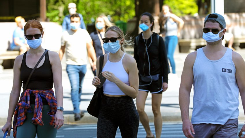 Mandatory Credit: Photo by Peter Foley/EPA-EFE/Shutterstock (10649806i)People exit Central Park wearing face covering in New York, New York, USA, 17 May 2020.