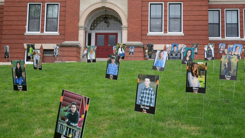Mandatory Credit: Photo by CJ GUNTHER/EPA-EFE/Shutterstock (10650716e)Nearly 250 portraits of the seniors of Marlborough High School are on display on the lawn of the Frank D Walker Building in Marlborough, Massachusetts, USA 18 May 2020.