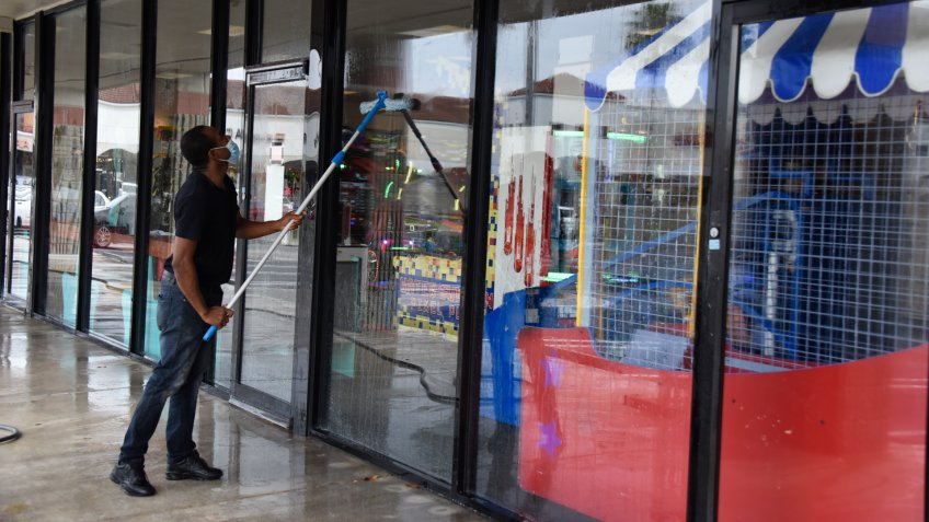 Mandatory Credit: Photo by Michele Eve Sandberg/Shutterstock (10650915an)Cleaners are getting ready for retail stores to open.