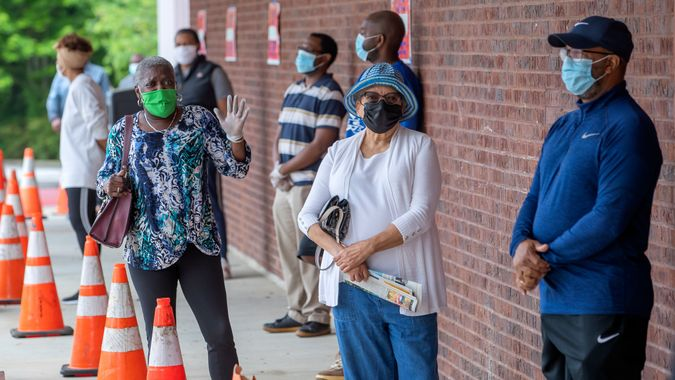 Mandatory Credit: Photo by ERIK S LESSER/EPA-EFE/Shutterstock (10650941l)People wait in line to cast their ballots as early voting begins for three primaries and elections, at the C.