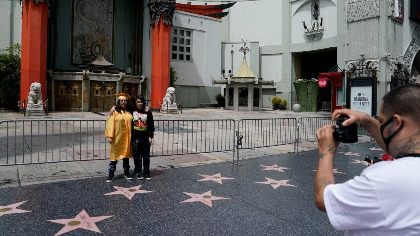 Mandatory Credit: Photo by Ashley Landis/AP/Shutterstock (10651181b)Kiara Hernandez, graduate of Cajon High School, poses for a photo outside TCL Chinese Theatre, in the Hollywood area of Los AngelesDaily Life California, Los Angeles, United States - 18 May 2020.