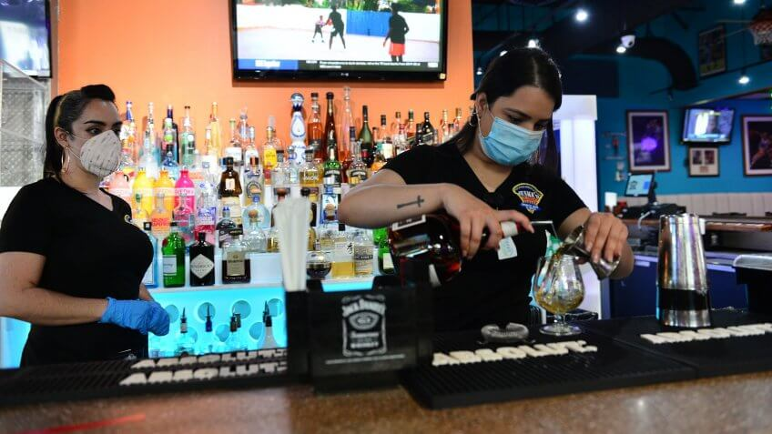 Mandatory Credit: Photo by JLN Photography/Shutterstock (10651280d)Juana's Latin Sports Bar & Grill bartenders preparing a drink for a customer.