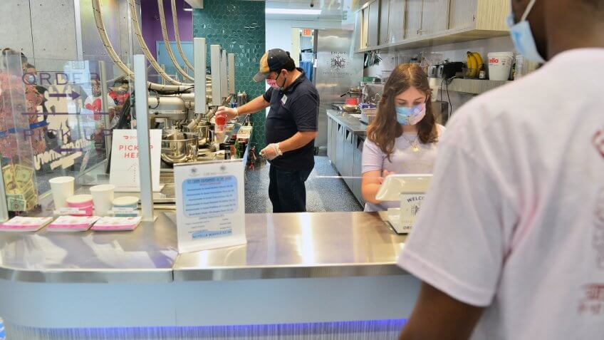 Mandatory Credit: Photo by JLN Photography/Shutterstock (10651280j)Customers can be seen dining on the first day at Freze N nitro creamery ice cream is being serve by owner Edward Gassed and 10 years old daughter Olivia for re-opens for indoor dining on May 18, 2020 in Miramar, Florida.