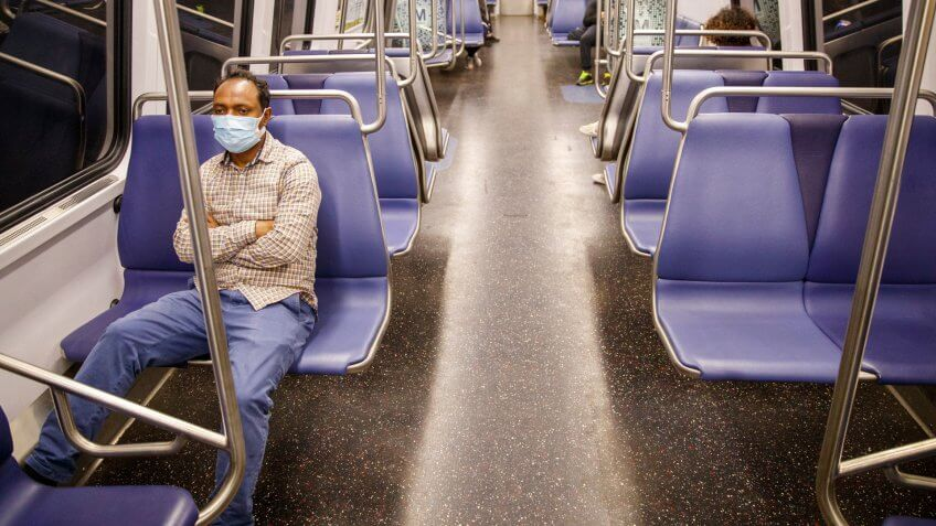 Mandatory Credit: Photo by SHAWN THEW/EPA-EFE/Shutterstock (10651949g)Metro riders on a train leaving Metro Center Station during the COVID-19 coronavirus pandemic in Washington, DC, USA, 19 May 2020.
