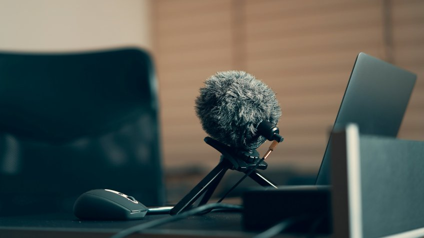 Laptop , microphone on a desk , e-learning area and equipments.