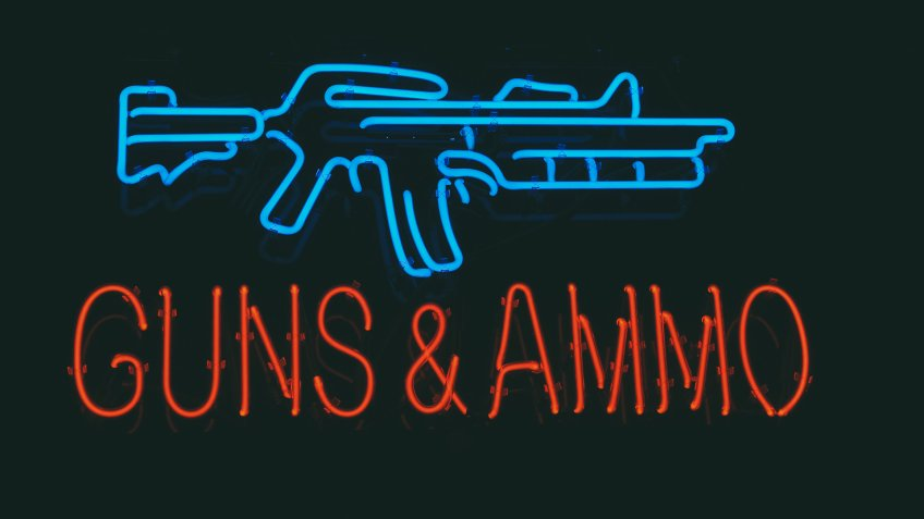 guns and ammo store sign