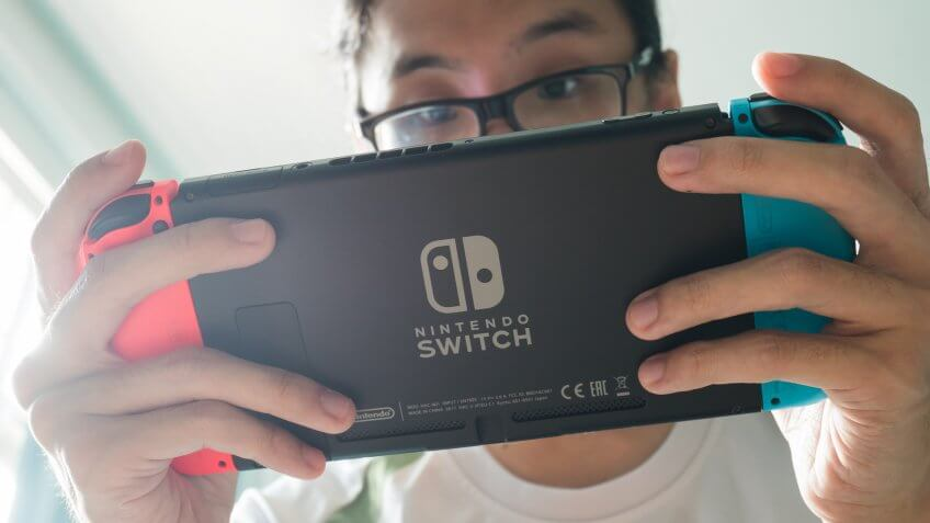 guy playing Nintendo Switch