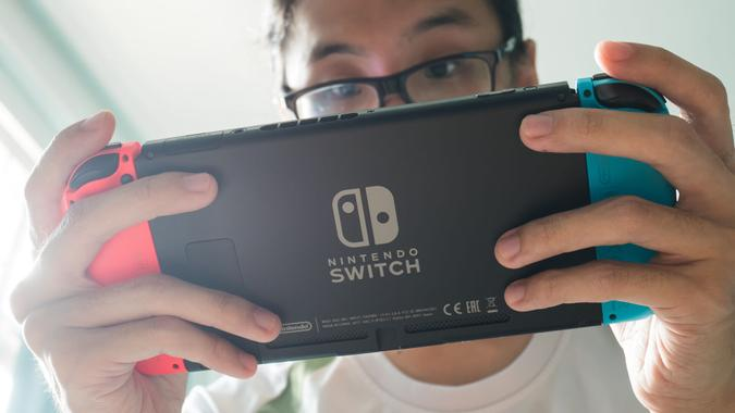 guy playing Nintendo Switch