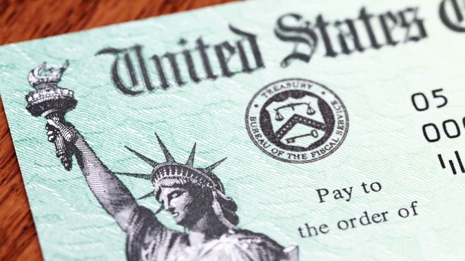 Partial view of a USA Treasury Internal Revenue Service tax refund check showing the Treasury seal and image of the Statue of Liberty.
