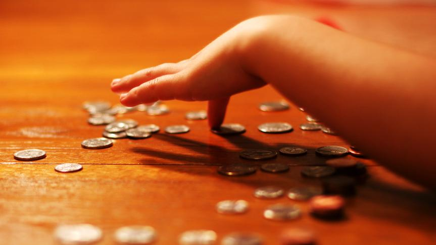 Child counting his monthly allowance.