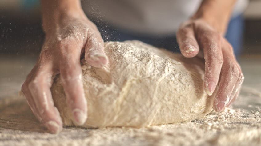 Kneading yeast dough.