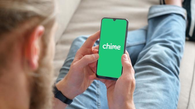 man using Chime bank mobile app