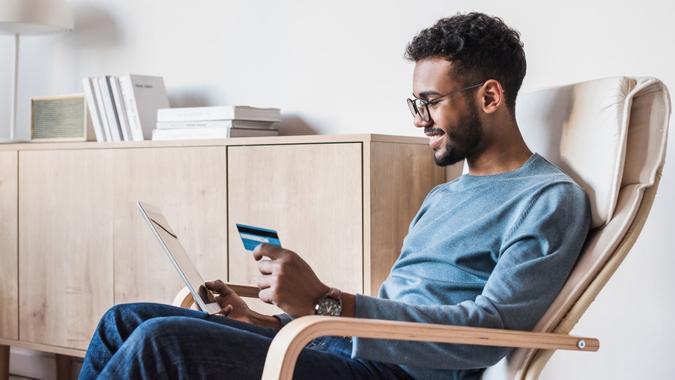 Internet shopper entering credit card information using digital tablet.