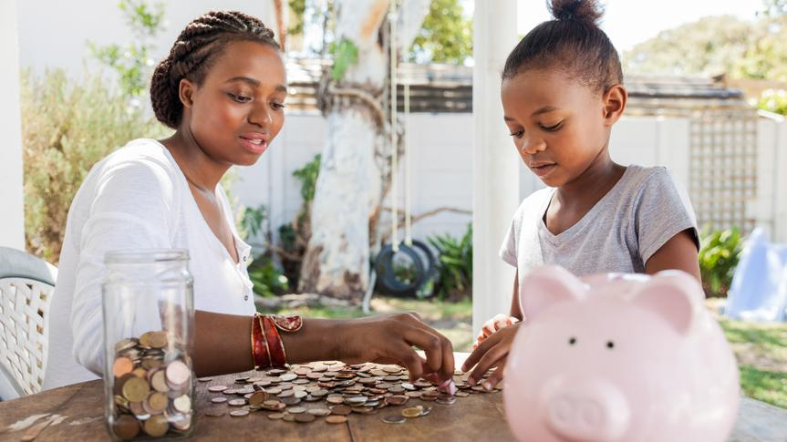 mother counting coins with her daughter