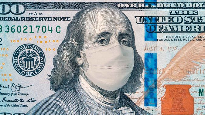 one hundred dollar bill with face mask