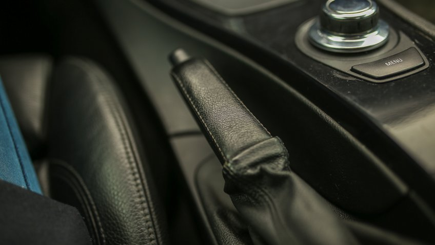 handbrake lever in a car with leather upholstery.