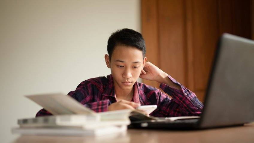 Teenage boy study hard to prepare for an exam at school.