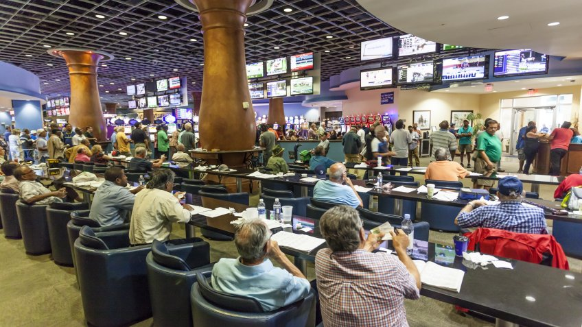 HALLANDALE BEACH, USA - MAR 11, 2017: People betting and gambling in the Gulfstream park casino in Hallandale Beach.