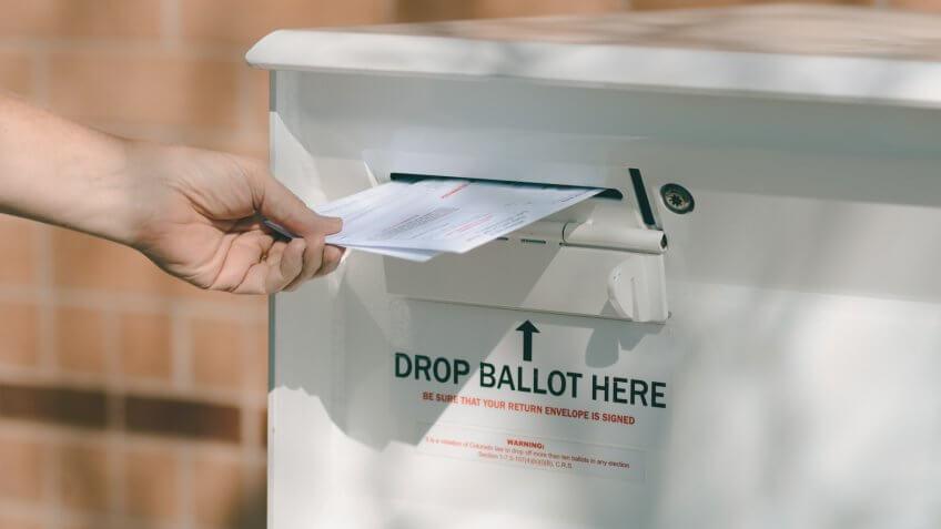 Arvada, Colorado, USA - October 23, 2016:  Hand delivering ballots to Jefferson County Drop Off Ballot Box.