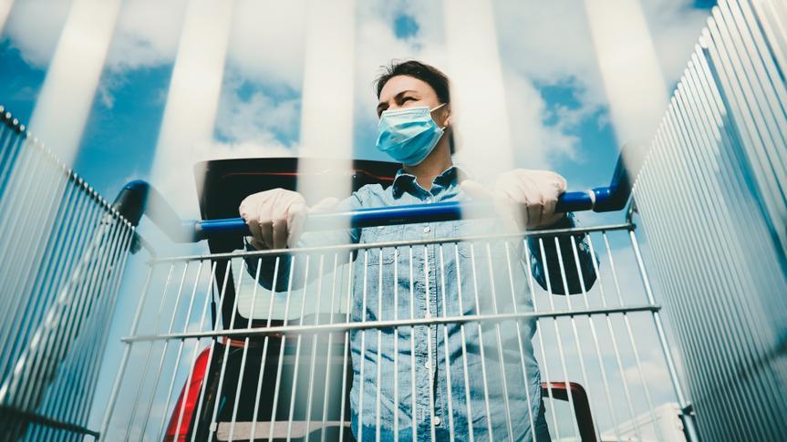 woman wearing mask pushing shopping cart