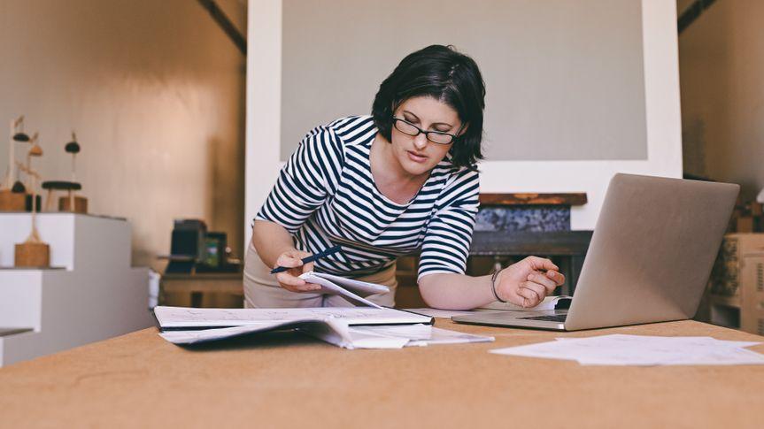 woman working at home preparing