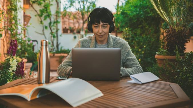 Woman at work from home patio during Covid-19 pandemic.