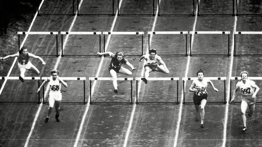Fanny Blankers-Koen; Shirley Strickland; Maureen Gardner Dutch athlete Fanny Blankers-Koen (692) at right, wins the women's 80 meters hurdles final in world record time at the Summer Olympic Games on at Wembley Stadium in London, United Kingdom.