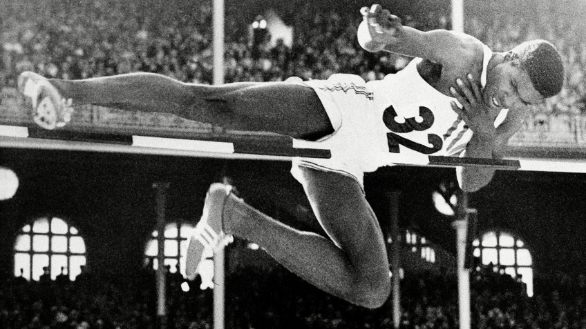 Charles Dumas, of the U.S., clears the bar during finals of the men's high jump competition who set a new Olympic record