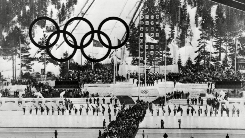Olympic athletes march into Blyth Arena, at Squaw Valley, Calif.