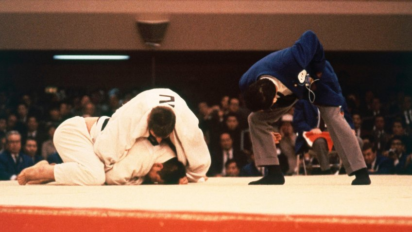 Seen here is Aston Geesink of the Netherlands and Aiko Kaminaga of Japan in heavyweight judo action at the 1964 Summer Olympics in Tokyo, Japan1964 Summer Olympics.