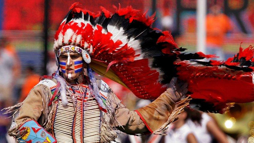 Mandatory Credit: Photo by Seth Perlman/AP/Shutterstock (6390045b)Chief Illiniwek University of Illinois' Mascot Chief Illiniwek preforms during the University of Illinois football game in Champaign, Ill.