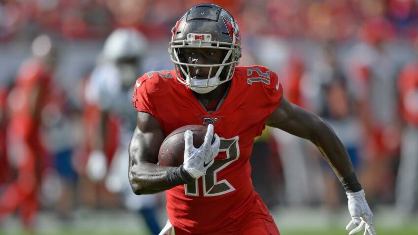 Mandatory Credit: Photo by Jason Behnken/AP/Shutterstock (10495469a)Tampa Bay Buccaneers wide receiver Chris Godwin (12) runs with the football after a reception against the Indianapolis Colts during the first half of an NFL football game, in Tampa, FlaBuccaneers Football, Tampa, USA - 08 Dec 2019.