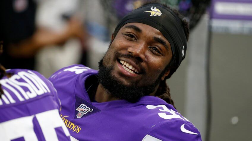 Mandatory Credit: Photo by Bruce Kluckhohn/AP/Shutterstock (10494805cx)Minnesota Vikings running back Dalvin Cook sits on the bench during the first half of an NFL football game against the Detroit Lions, in MinneapolisLions Vikings Football, Minneapolis, USA - 08 Dec 2019.