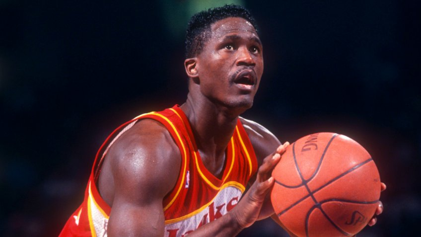 PHILADELPHIA, PA - FEBRUARY 27:  Dominique Wilkins #21 of the Atlanta Hawks shoots the free-throw during an NBA game against the Philadelphia 76ers on February 27, 1991 at the Spectrum in Philadelphia, Pennsylvania.