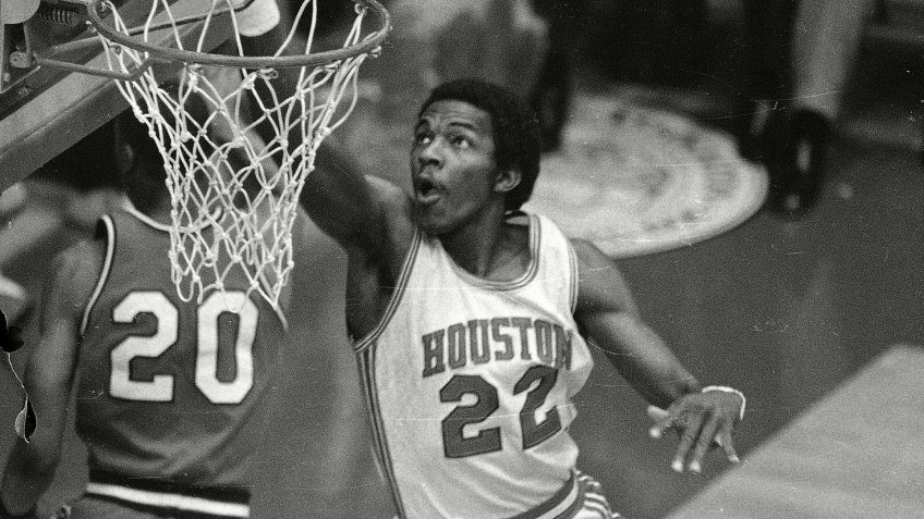 Drexler Clyde dunks the ball during NCAA play between Houston and Louisville in Albuquerque, N.