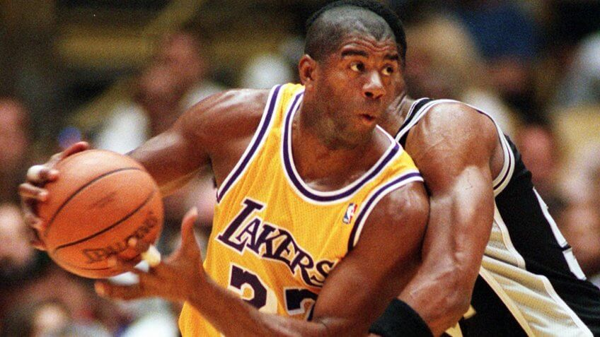"""SMITH JOHNSON Los Angeles Lakers' Earvin """"Magic"""" Johnson spins around a pick thrown by San Antonio Spurs' Charles Smith during the first quarter, in Inglewood, Calif."""