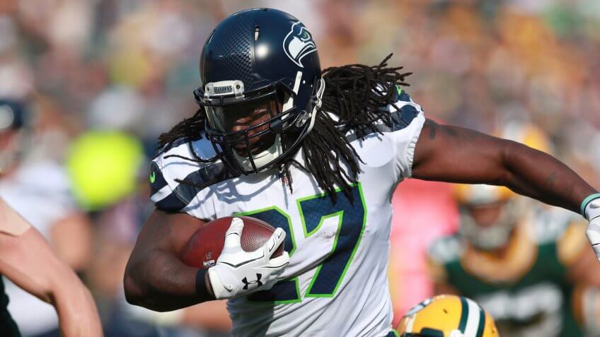 Mandatory Credit: Photo by AP/Shutterstock (9175898ax)Seattle Seahawks running back Eddie Lacy (27) runs the ball against the Green Bay Packers during an NFL football game, in Green Bay, WisSeahawks Packers Football, Green Bay, USA - 10 Sep 2017.