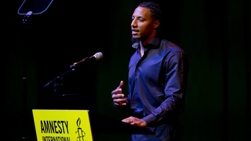 Former NFL quarterback and social justice activist Eric Reid speeches for his friend and colleague Colin Kaepernick who was awarded the Amnesty International Ambassador of Conscience Award for 2018 in Amsterdam, .