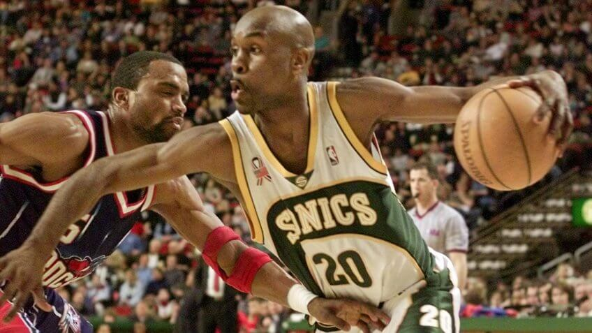 PAYTON MOBLEY Seattle SuperSonics' Gary Payton drives against Houston Rockets' Cuttino Mobley during the third quarter in Seattle, .