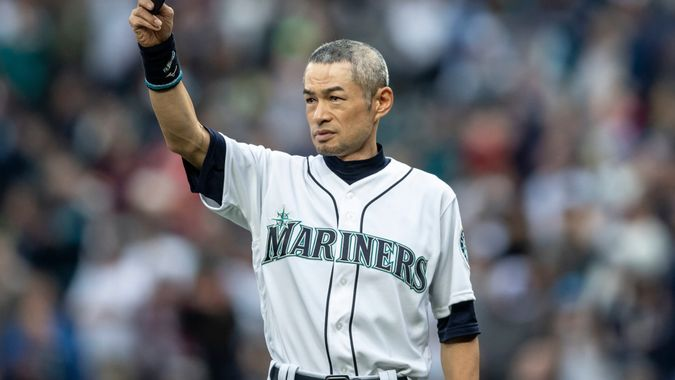 """Mandatory Credit: Photo by Stephen Brashear/AP/Shutterstock (10418775c)Former Seattle Mariners player Ichiro Suzuki acknowledges the crowd during a ceremony in which he was presented withe Seattle Mariners """"Franchise Acheivement Award"""" before a baseball game between the Chicago White Sox and the Seattle Mariners, in Seattle."""