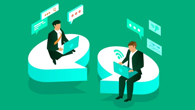 Two businessmen sitting on a speech bubble communicating.