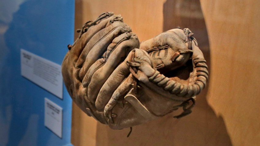 "Mandatory Credit: Photo by Seth Wenig/AP/Shutterstock (10077221f)A glove used by Brooklyn Dodgers baseball player Jackie Robinson is displayed at the exhibit ""In the Dugout with Jackie Robinson: An Intimate Portrait of a Baseball Legend"" at the Museum of City of New York in New York."