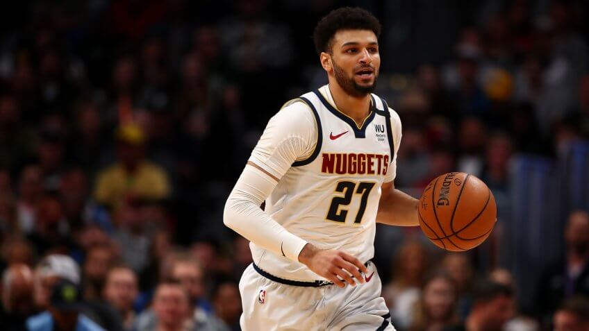 DENVER, CO - MARCH 09: Jamal Murray #27 of the Denver Nuggets dribbles up court against the Milwaukee Bucks at Pepsi Center on March 9, 2020 in Denver, Colorado.