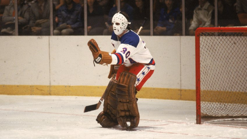 American hockey player Jim Craig, goalkeeper for Team USA, stick out his glove to make a save in an exhibition game against the Soviet team at Madison Square Garden, New York, New York, February 1980.