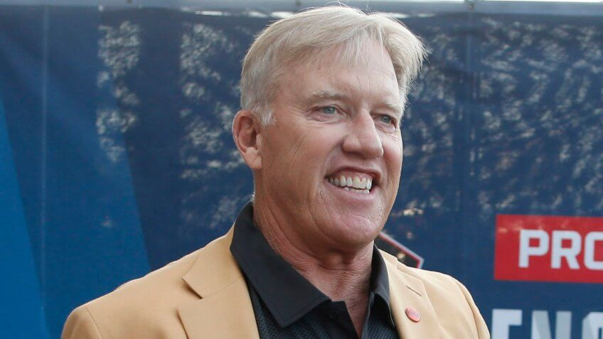Former NFL player John Elway is introduced before the induction ceremony at the Pro Football Hall of Fame, in Canton, OhioHall of Fame Football, Canton, USA - 03 Aug 2019.