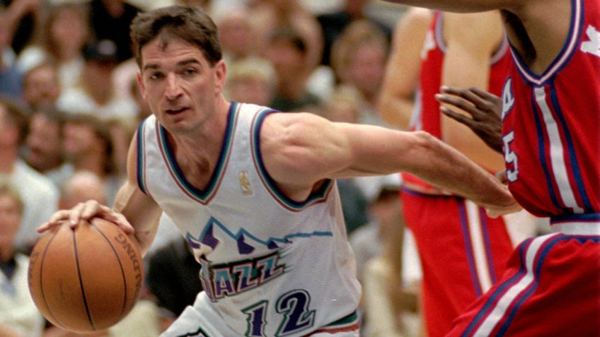STOCKTON MARTIN Utah Jazz guard John Stockton glides past Los Angeles Clippers guard Darrick Martin on his way to the basket in the fourth quarter, in Salt Lake City.