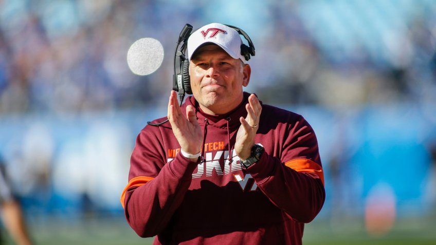 Virginia Tech head coach Justin Fuente reacts after his team scores against Kentucky in the first half of the Belk Bowl NCAA college football game in Charlotte, N.