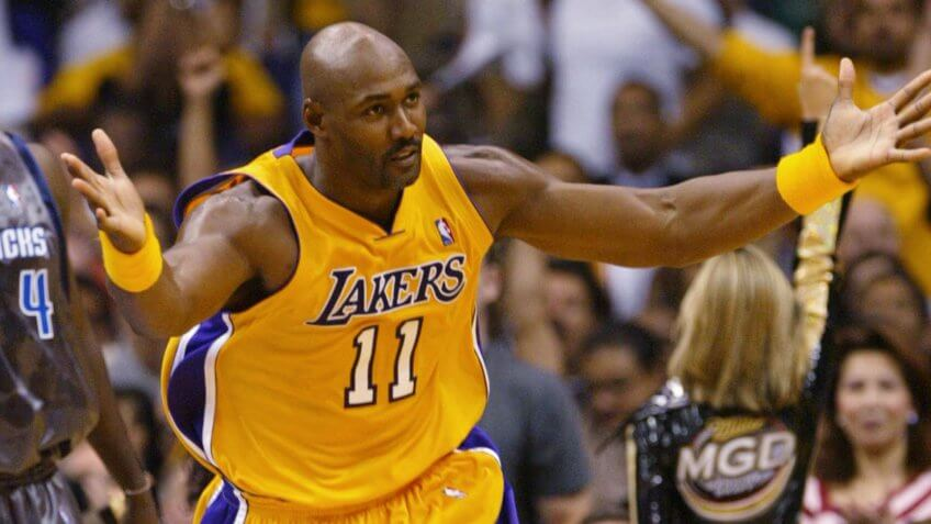 MALONE FINLEY Los Angeles Lakers' Karl Malone, right, looks for the foul call after scoring against Dallas Mavericks' Michael Finley during the fourth quarter, at the Staples Center in Los Angeles.