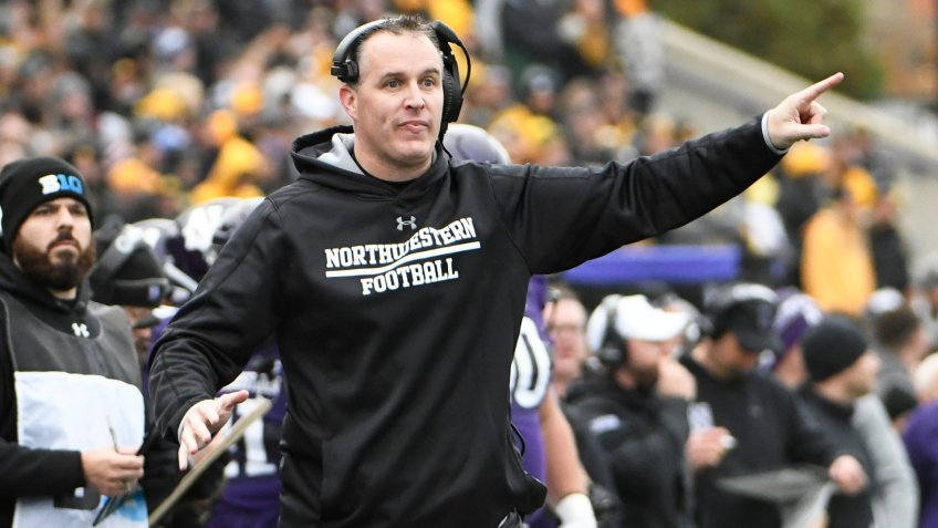 Northwestern head coach Pat Fitzgerald gestures to his team during the first half of an NCAA college football game against Iowa, in Evanston, IllIowa Northwestern Football, Evanston, USA - 26 Oct 2019.